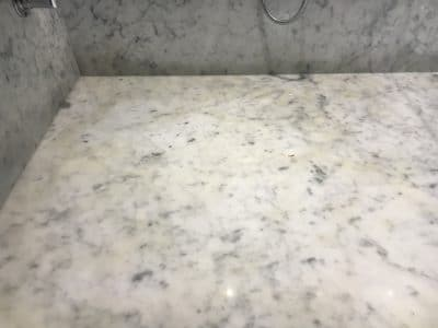 Marble Shower Humidity Contamination Stain Removal | Close up of the stains.