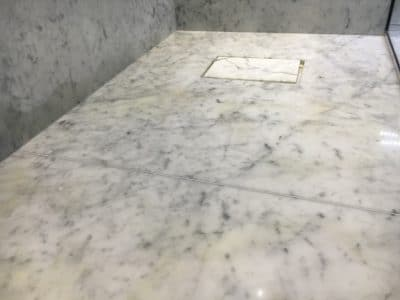 Marble Shower Humidity Contamination Stain Removal | Another close up shows the line on the wall tiles close to the floor nicely.