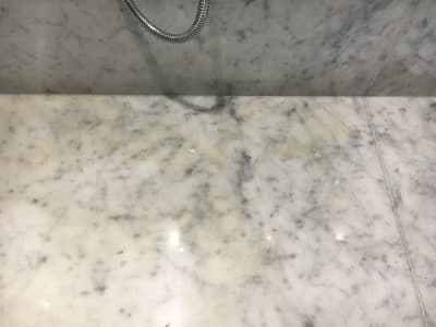 Marble Shower Humidity Contamination Stain Removal | Yellowish stains dominated the floor stone.