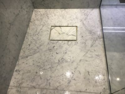 Marble Shower Humidity Contamination Stain Removal | Floor is being washed with stone cleaner.