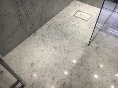 Marble Shower Humidity Contamination Stain Removal | Overview of the repair shows no stains at all and the line at the bottom of the stone has disappeared as well saving a failed 'hand over day' and thousands of pounds!