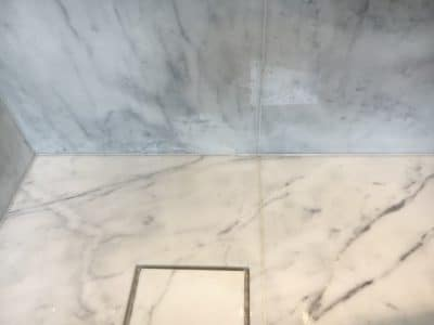 Marble Shower Rust Stain Removal | The stain area looks clean and white and doesn't attract attention any more.