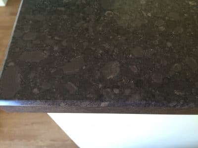 Quartz Kitchen Top Acid Stain Removal | After the cleaning and repair it is almost completely gone and only visible up close.