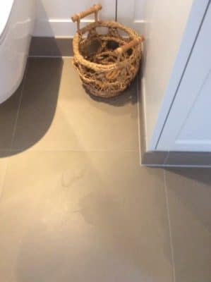 Shower Room Ceramic Floor Tile Stain Removal | Another angle of the stain.