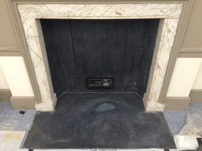 Traditional Palace Marble Fireplace Restoration C | The fireplace looks dirty and shows cracks and stains