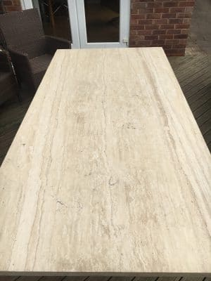 Travertine Stone Table Damage From Fallen Roof Tiles | Overview of the table in damaged state.