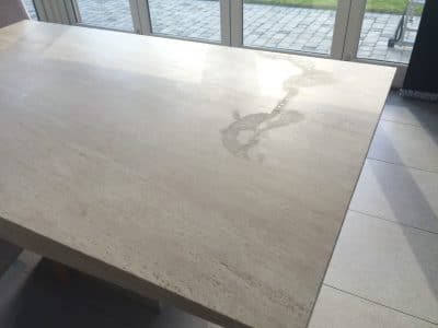 Travertine Table Top Etch Stain Removal | View of etch stain is very visible from anywhere in the room.
