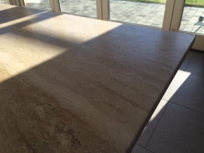 Travertine Table Top Etch Stain Removal | Close up of the repair area after the polishing process.