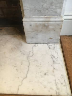 White Marble Fireplace Stain Removal | The surrounding stone has brownish humidity stains that normally take 24h to remove.