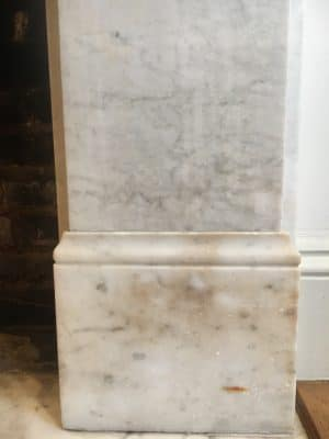 White Marble Fireplace Stain Removal | Close up of the main stain and rust mark that caused the owner to contact us.