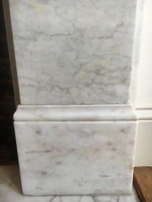 White Marble Fireplace Stain Removal | After 8 hours of cleaning and stain removal there's only a small mark left and the owner is happy with a short repair session.
