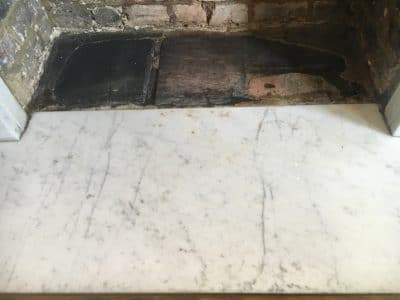 White Marble Fireplace Stain Removal | The hearth shows only minor rust stains near where the fire used to be burning this is usually caused by the metalwork that holds the logs.