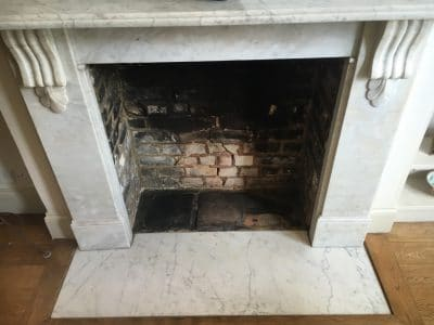 White Marble Fireplace Stain Removal | Overview at the end of the day looks cleaner and considering the short amount of time it was treated for, it made a big improvement.