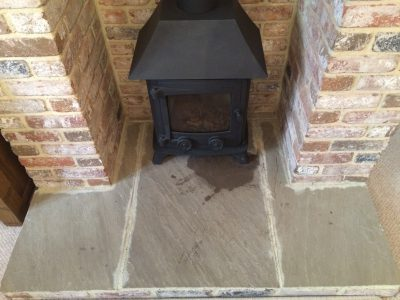 York Stone Fireplace Hearth Oil Stain Removal | Oil Stain clearly visible on York.stone hearth