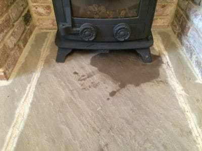 York Stone Fireplace Hearth Oil Stain Removal | Close up of the stain to the York stone.