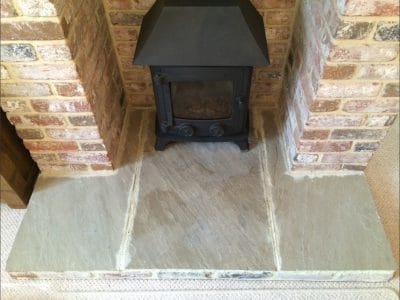 York Stone Fireplace Hearth Oil Stain Removal | After the second clean up of the treatment the stone looks cleaner and the large dark stain is virtually gone and you wouldn't think a stain was present.